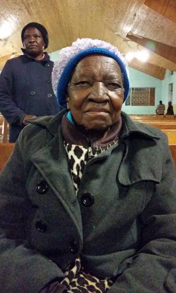 Eggester Jokomo sits inside St. Mark United Methodist Church in Harare, Zimbabwe following morning prayer.