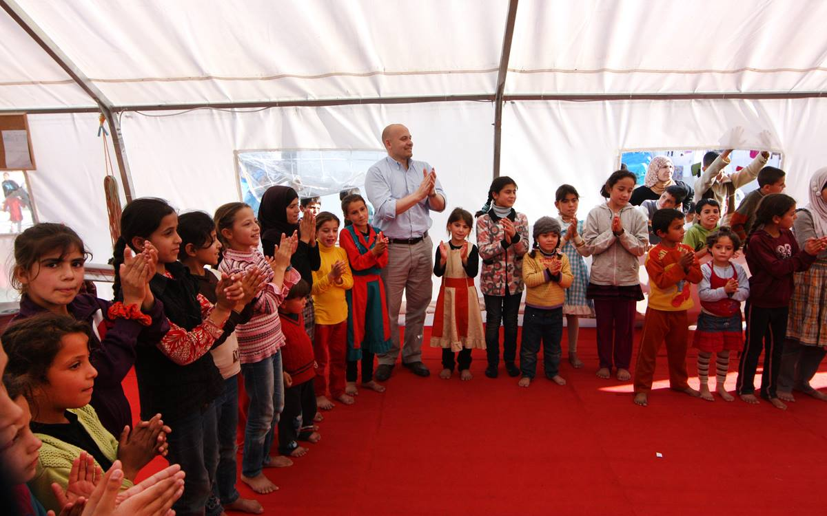 Francesco Paganini, manager of international disaster response for the United Methodist Committee on Relief, joins in an activity while visiting the UMCOR-supported child-friendly space for Syrian refugees in Turkey. Photo by James Rollins, UMCOR