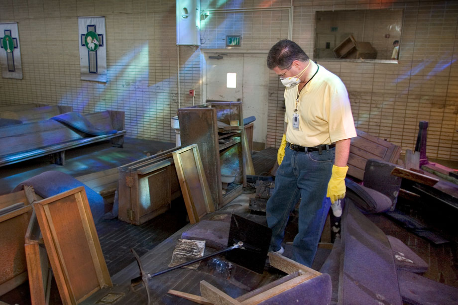 The Rev. Darryl Tate views the ruined sanctuary of St. Luke's United Methodist Church in New Orleans for the first time since he fled Hurricane Katrina in this 2005 file photo. File photo by Mike DuBose, UMNS.