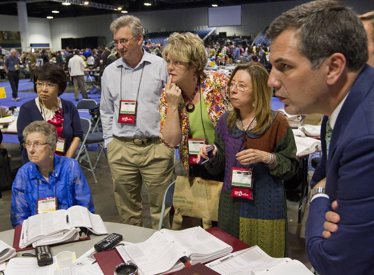 "Members of the Virginia delegation huddle to discuss possible next steps after the United Methodist Judicial Council ruled the proposed ""Plan UMC"" for church restructuring to be unconstitutional during the 2012 United Methodist General Conference in Tampa, Fla. Photo by Mike DuBose, UMNS. Accompanies UMNS story #348. 12/17/12.;"
