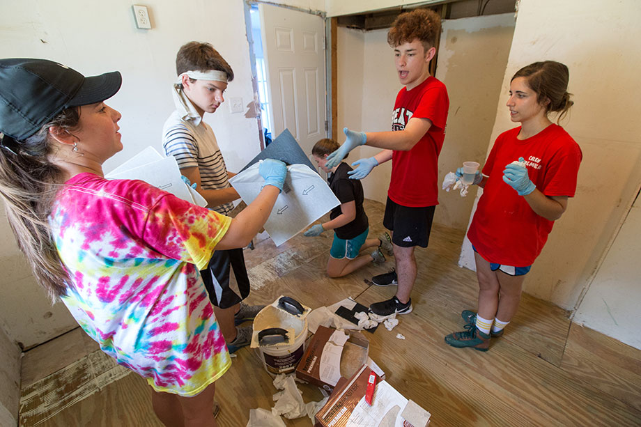 Members of a volunteer team from First United Methodist Church in Wichita Falls, Texas, install floor tiles in a Slidell, La., home damaged by Hurricane Katrina. Photo by Mike DuBose, UMNS.