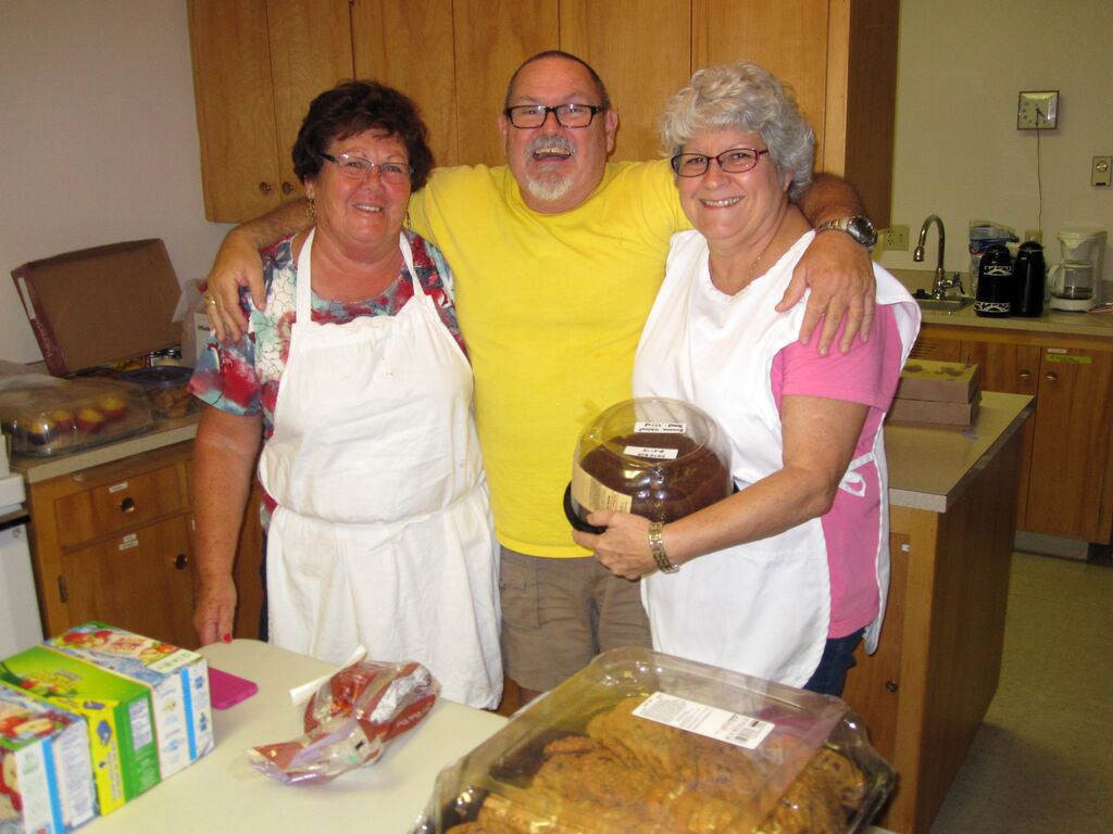 From left, Linda Robinson, Clint Baker and Nancy Baker are among the volunteers providing meals and shelter to residents finding refuge from wildfires at Pateros Community United Methodist Church in Washington. Photo by Jim Truitt