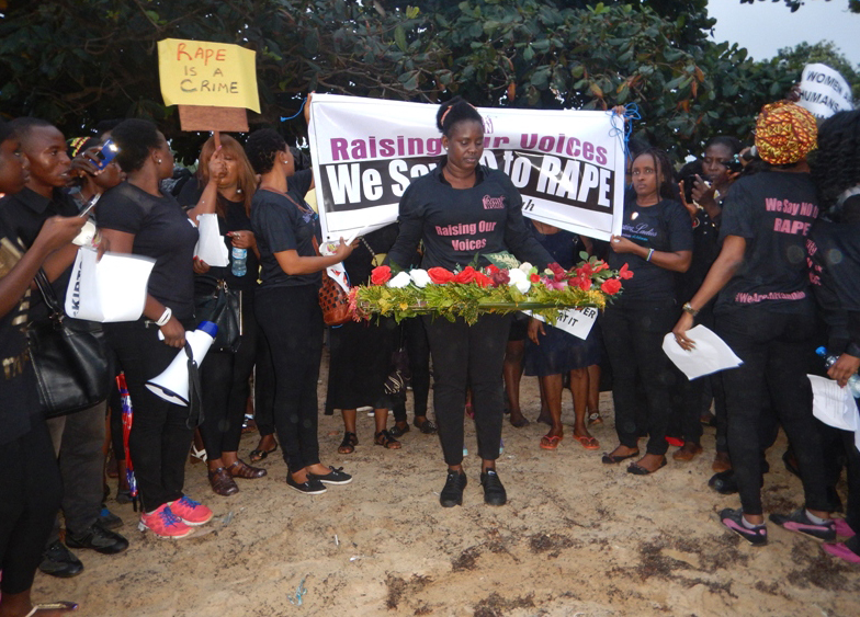 Women lay wreaths at the spot where Hannah Bockaire's body was found on Lumley Beach in western Freetown, Sierra Leone.  United Methodists are among those protesting her brutal death and alleged gang rape. Photo by Phileas Jusu, UMNS