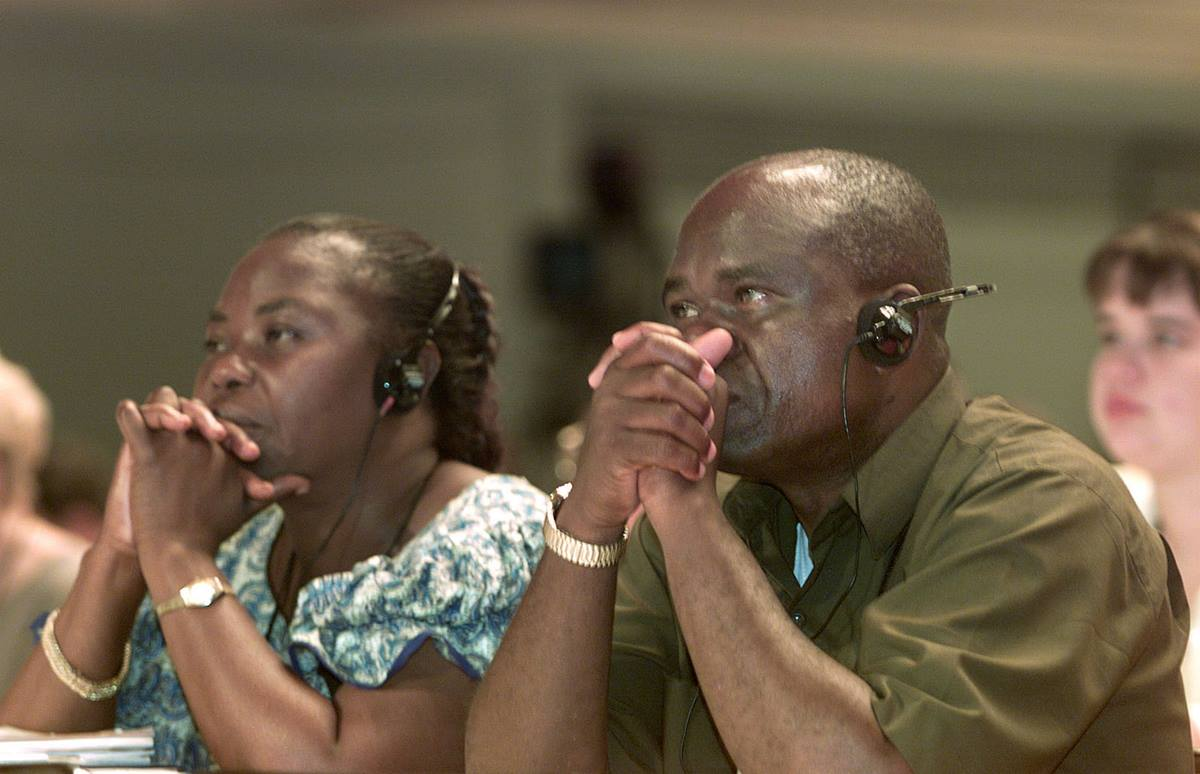 Delegates from South Congo, listen to French translation during a session of the United Methodist Church's 2000 General Conference in Cleveland UMNS photo by Mike DuBose