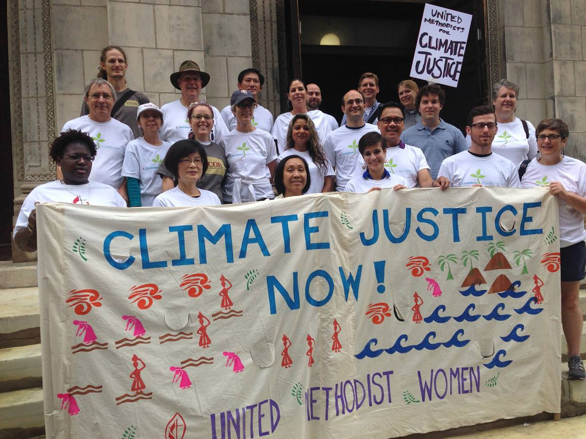 One group of United Methodists participating in the People's Climate March on Sept. 21, 2014, in New York gather on the steps of the United Methodist Church of Saint Paul and Saint Andrew before heading south to join an interfaith gathering ahead of the march. 2014 file photo by Linda Bloom, UMNS