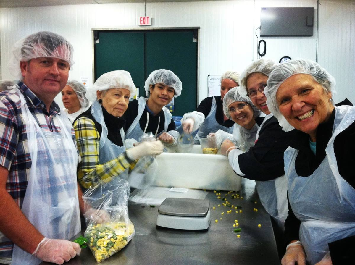 With a strong belief in social outreach, members of First United Methodist Church in Portland volunteer at the Oregon Food Bank in Beaverton, Ore. Photo by Mark Ohlson, courtesy of First United Methodist Church