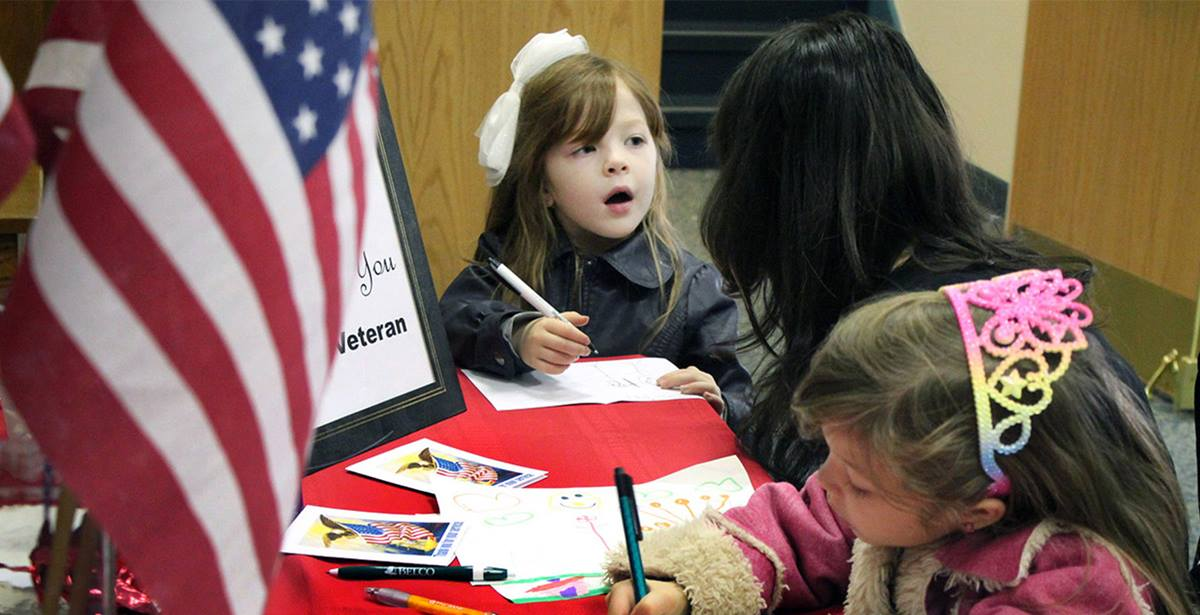 Children at First United Methodist Church of Lancaster, Pa., write thank you notes to give to wounded veterans and those serving in the military. A UMNS photo by Gwen Kisker.