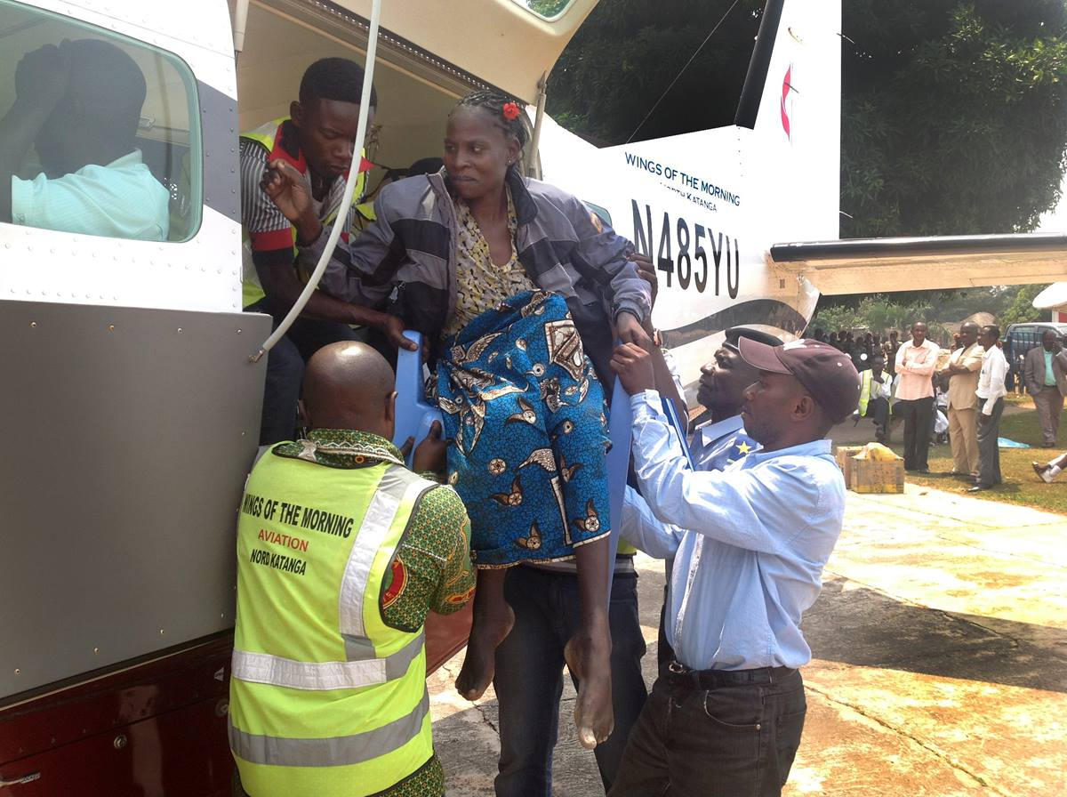 A Kamina woman who needs medical care is helped onto Wings of the Morning for a flight to Lumumbashi. Photo courtesy of Betty Kazadi Musau