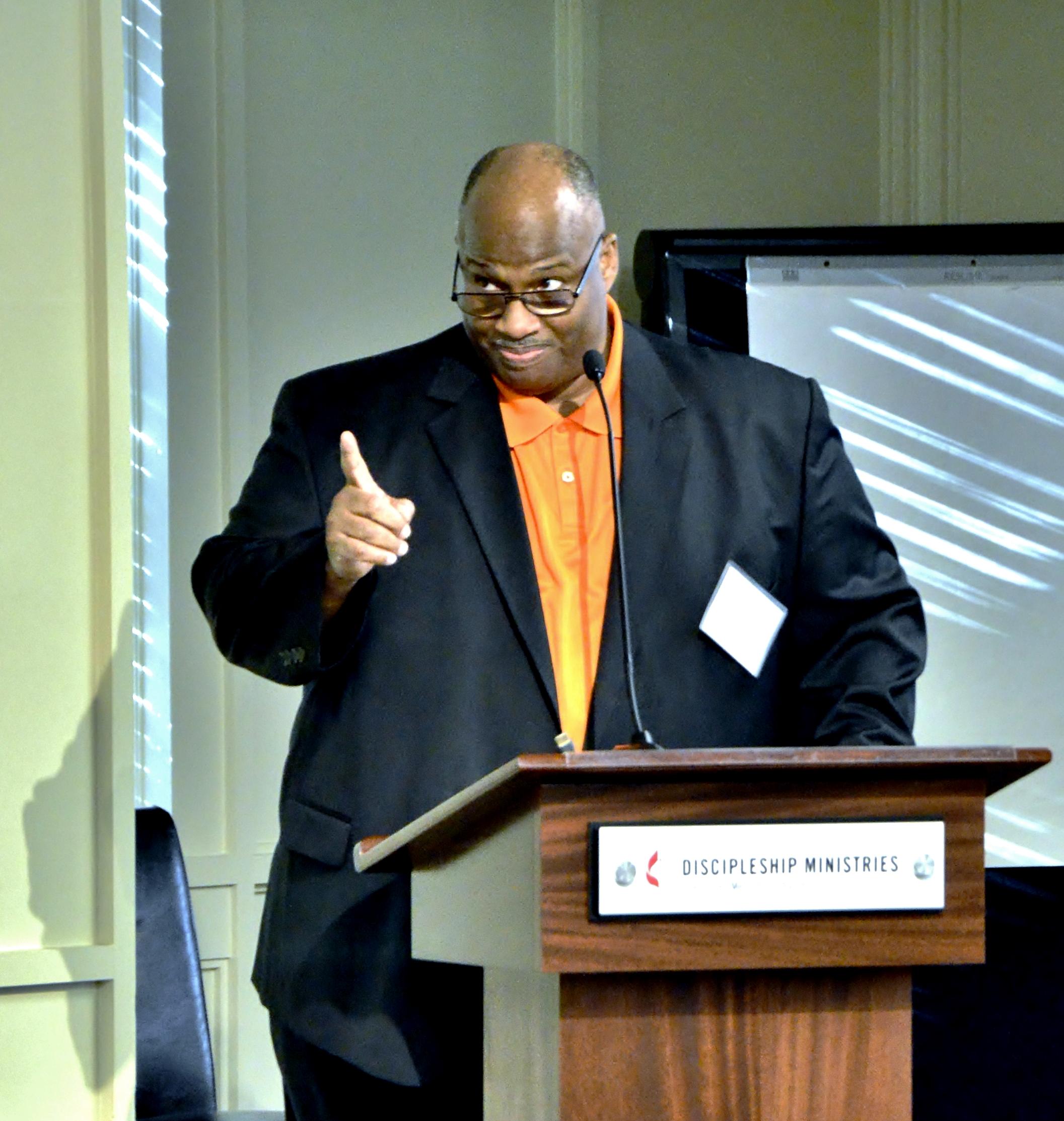 Bishop Darryl B. Starnes Sr. of the African Methodist Episcopal Zion Church leads opening devotion at the North American ecumenical evangelism conference. He encouraged Christians to take a broad approach to evangelism, sharing the good news by word, service and signs. Photo© by Tom Gillem