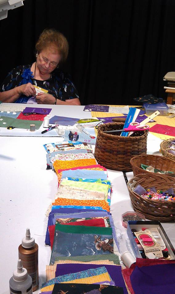 Ellen Johnsen works on a quilt square for a larger quilt from the collective squares decorated by participants at the 2012 General Conference in Tampa, Fla. Photo by Leigh Rogers, UMW