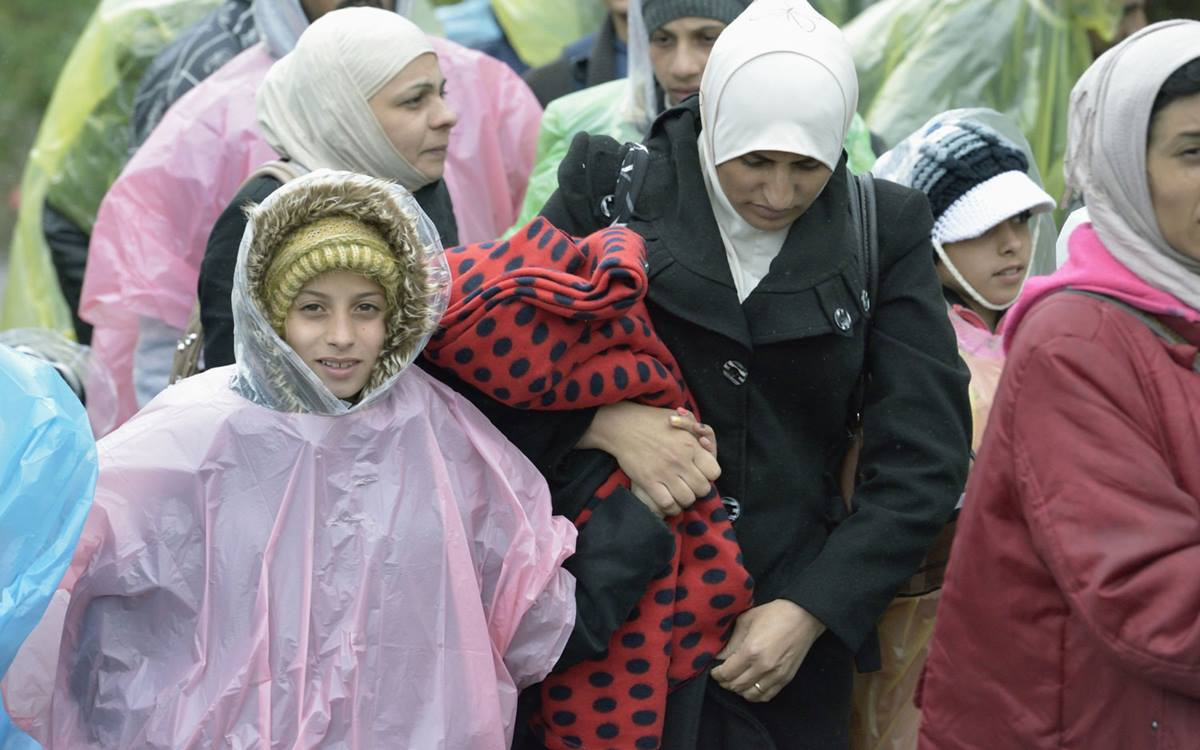 At Berkasovo, Serbia, refugees from Syria and other countries cross the border into Croatia on Sept. 28, 2015. A 2015 file photo by Paul Jeffrey for the ACT Alliance