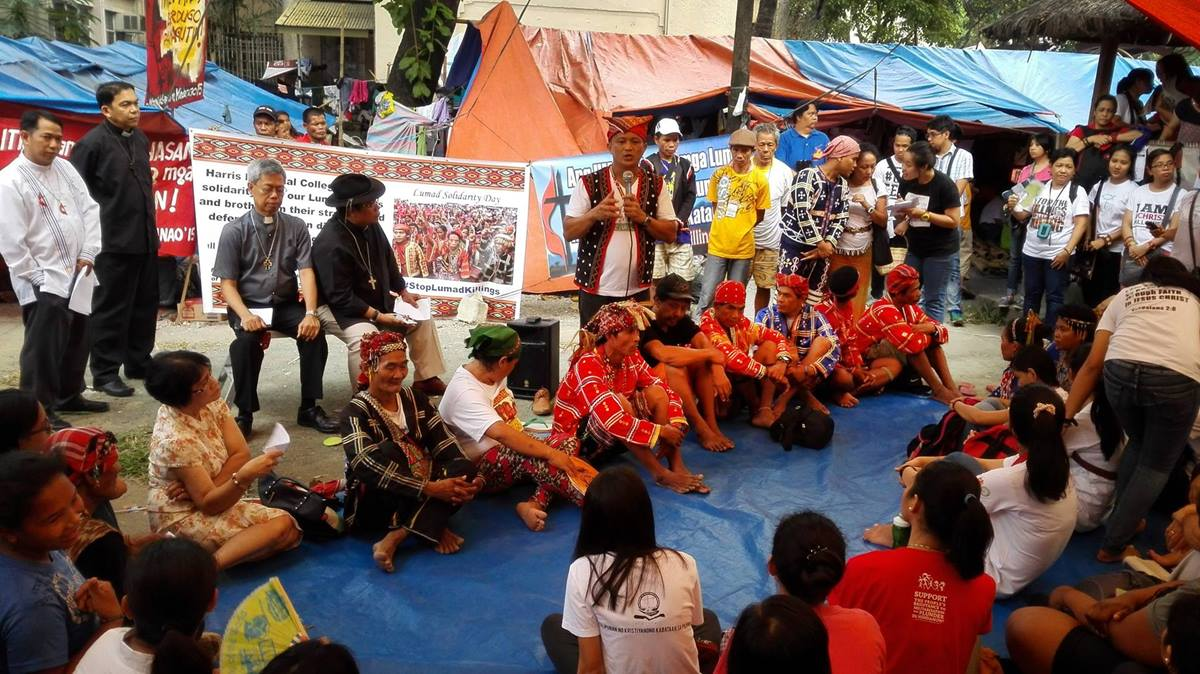 During Lumad Solidarity Day, Datu Dulphing Ogan (standing) expresses his gratitude. Datu means chief. Seated, third from the left, is the Rev. Joey Umali with other United Methodist leaders and the Lumad people. A UMNS photo courtesy of Noel Vincent P. Miguel.