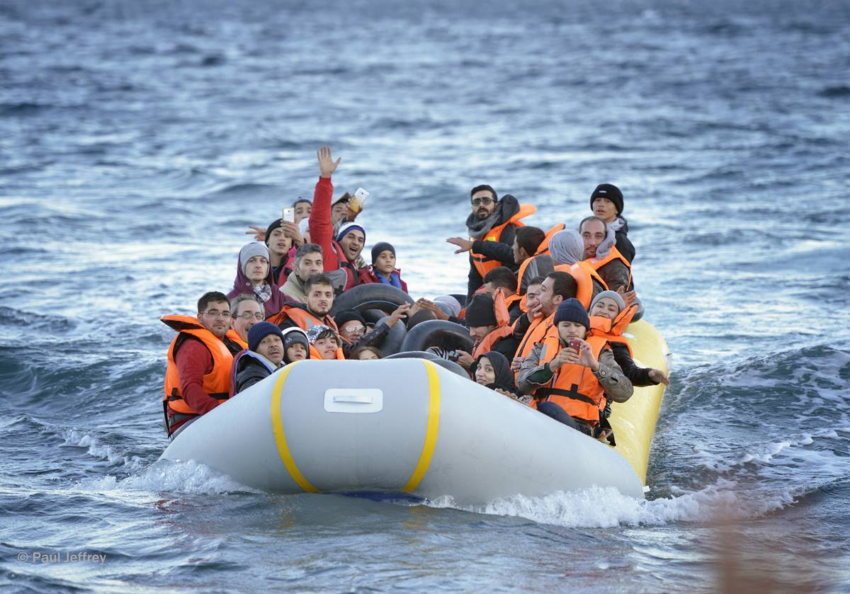 Refugees travel in a rubber boat across the Aegean Sea from Turkey to the Greek island of Lesbos on Nov. 2, 2015.  They were received on a beach near Molyvos by local and international volunteers, then proceeded on their way toward western Europe. The boat was provided by Turkish traffickers to whom the refugees paid huge sums to arrive in Greece.