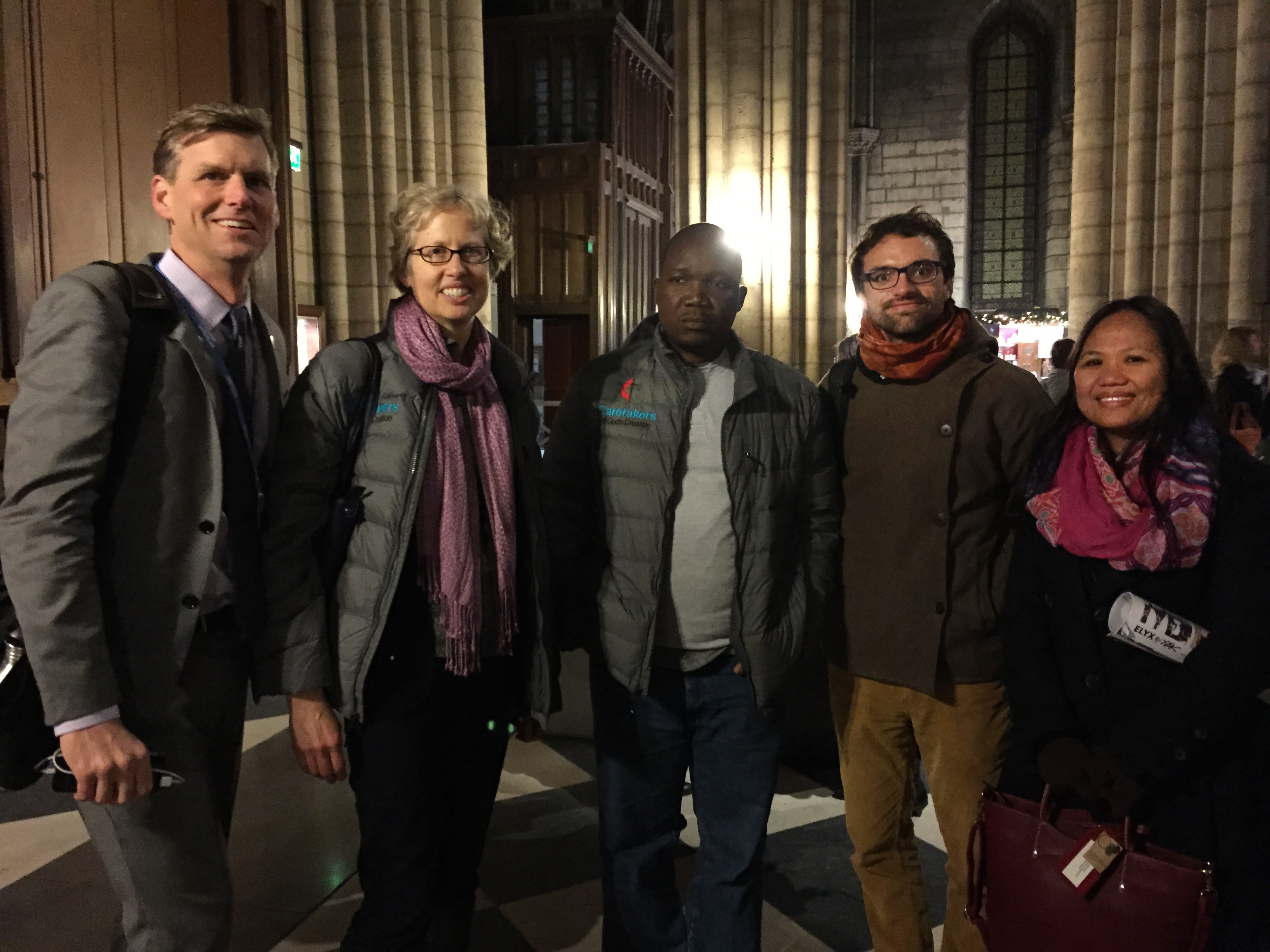 From left, John Hill and Susan Mullen, U.S., Jefferson Knight, Liberia; Daniel Obergfell, Germany, and Jennifer Ferariza Meneses, Philippines, at the Cathedral of Notre Dame in Paris. They were part of the teams from the United Methodist boards of Global Ministries and Church and Society at the U.N. climate summit. Photo courtesy of the Board of Church and Society