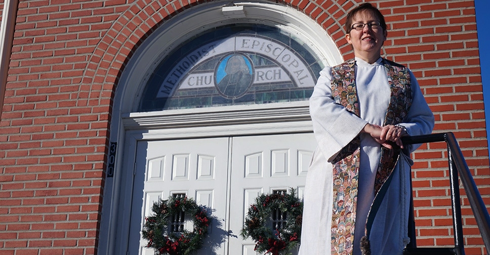 The Rev. Cynthia Meyer stands in front of the Edgerton United Methodist Church in Edgerton, Kansas, where she is lead pastor. She came out to the congregation during her sermon on Jan. 3. Photo courtesy of Reconciling Ministries Network