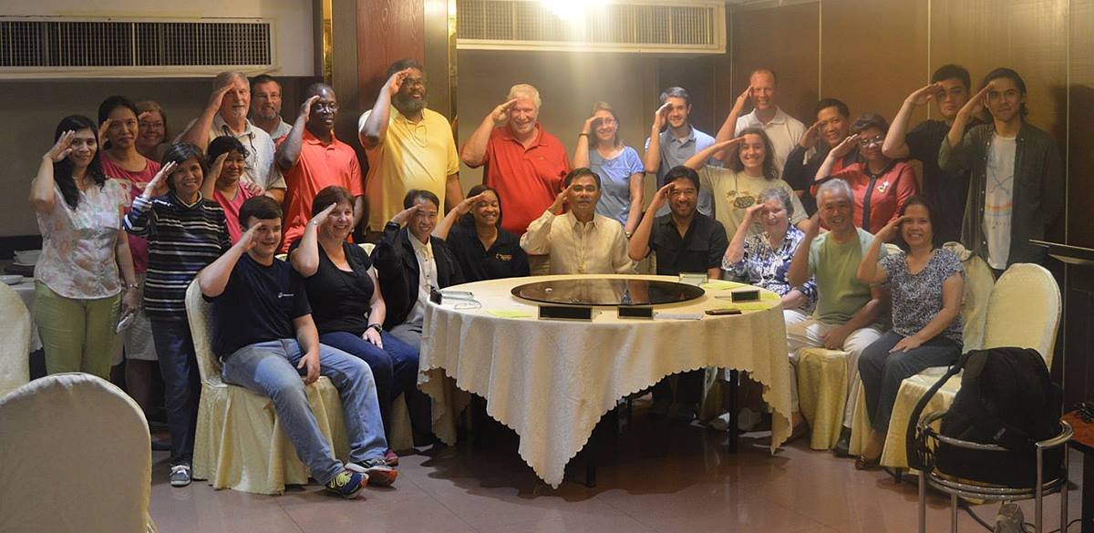 The Bridges Philippines Team, with other Filipino coordinators led by the Philippine Bridges Coordinator Dr. Glen Roy Paraso (seated second from right) and the area bishop (Seated center) Bishop Rodolfo Juan. Photo courtesy of Wilfredo Ramos