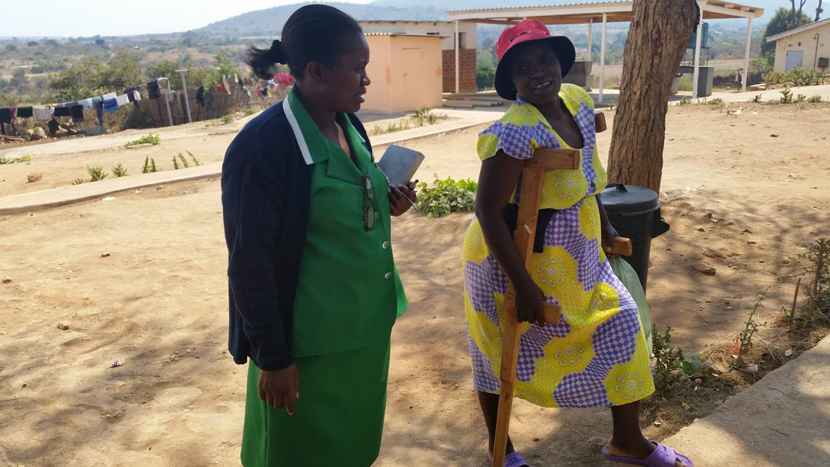 Acting matron Mtokoma chats with Stella Mabhogo who was making her way to the main hospital complex for a meal. Photo by Eveline Chikwanah, UMNS