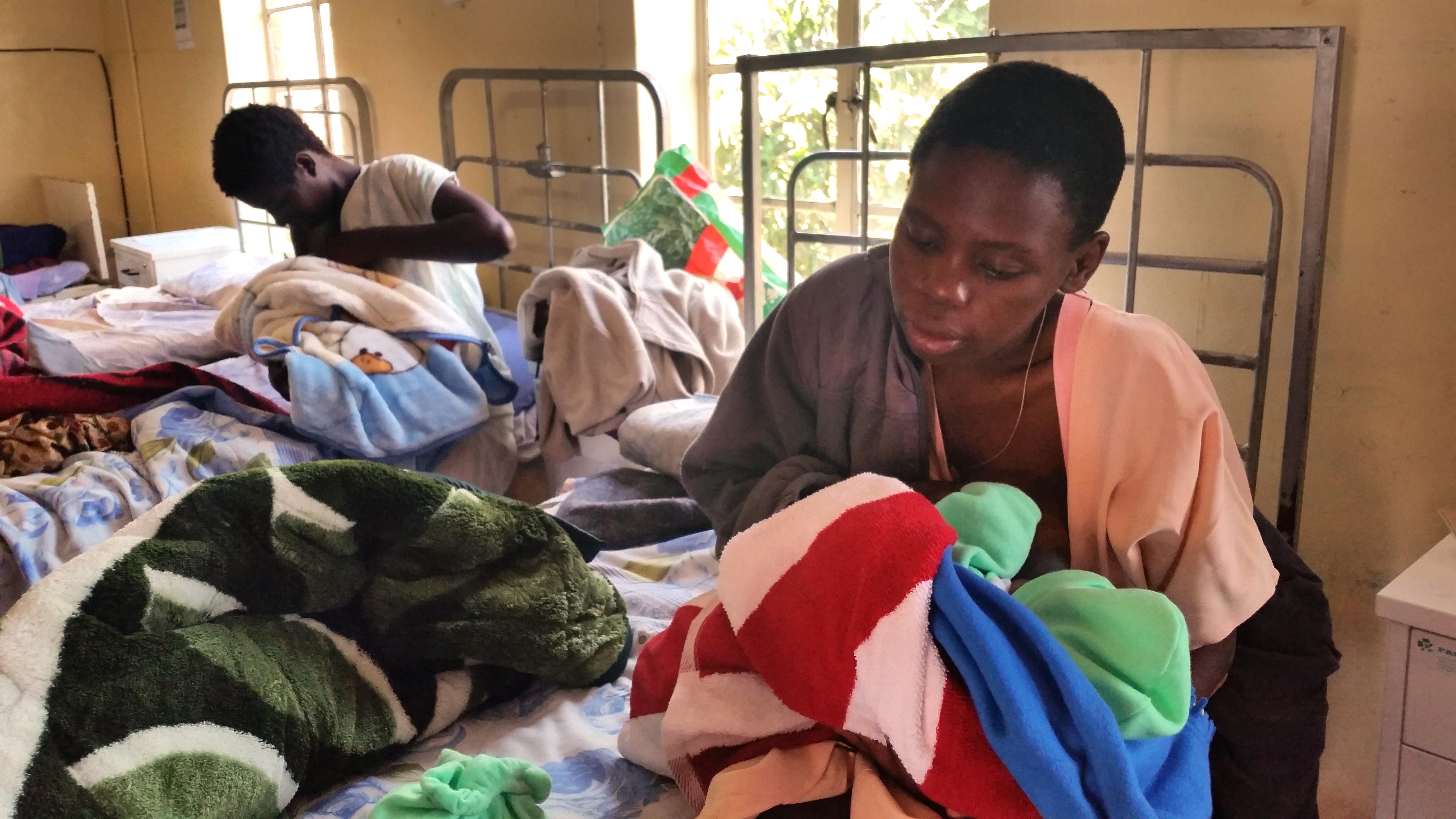 Mary Chimunda breastfeeds her newborn son in the Mutambara Mission Hospital in Zimbabwe. Photo by Eveline Chikwanah, UMNS
