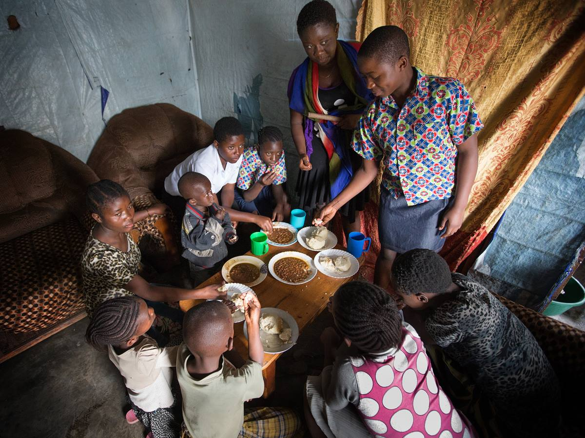 Children share a meal at the United Methodist orphanage in Goma, Democratic Republic of Congo.