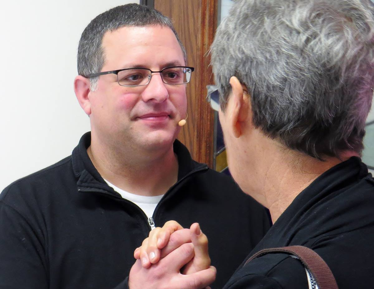 The Rev. Omar Rikabi, pastor of First United Methodist Church in Heath, Texas, greets a parishioner after worship on Jan. 17. UMNS photo by Sam Hodges
