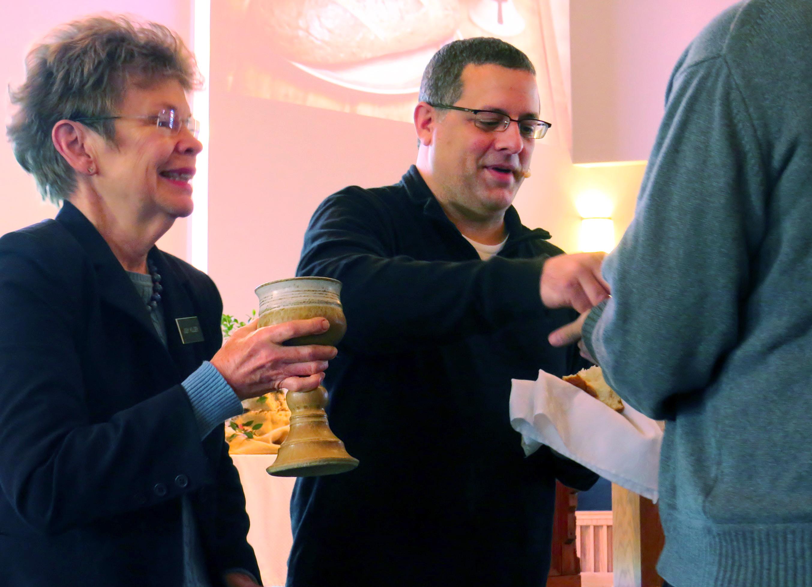 The Rev. Omar Rikabi offers communion on Jan. 17 at First United Methodist Church in Heath, Texas. UMNS photo by Sam Hodges