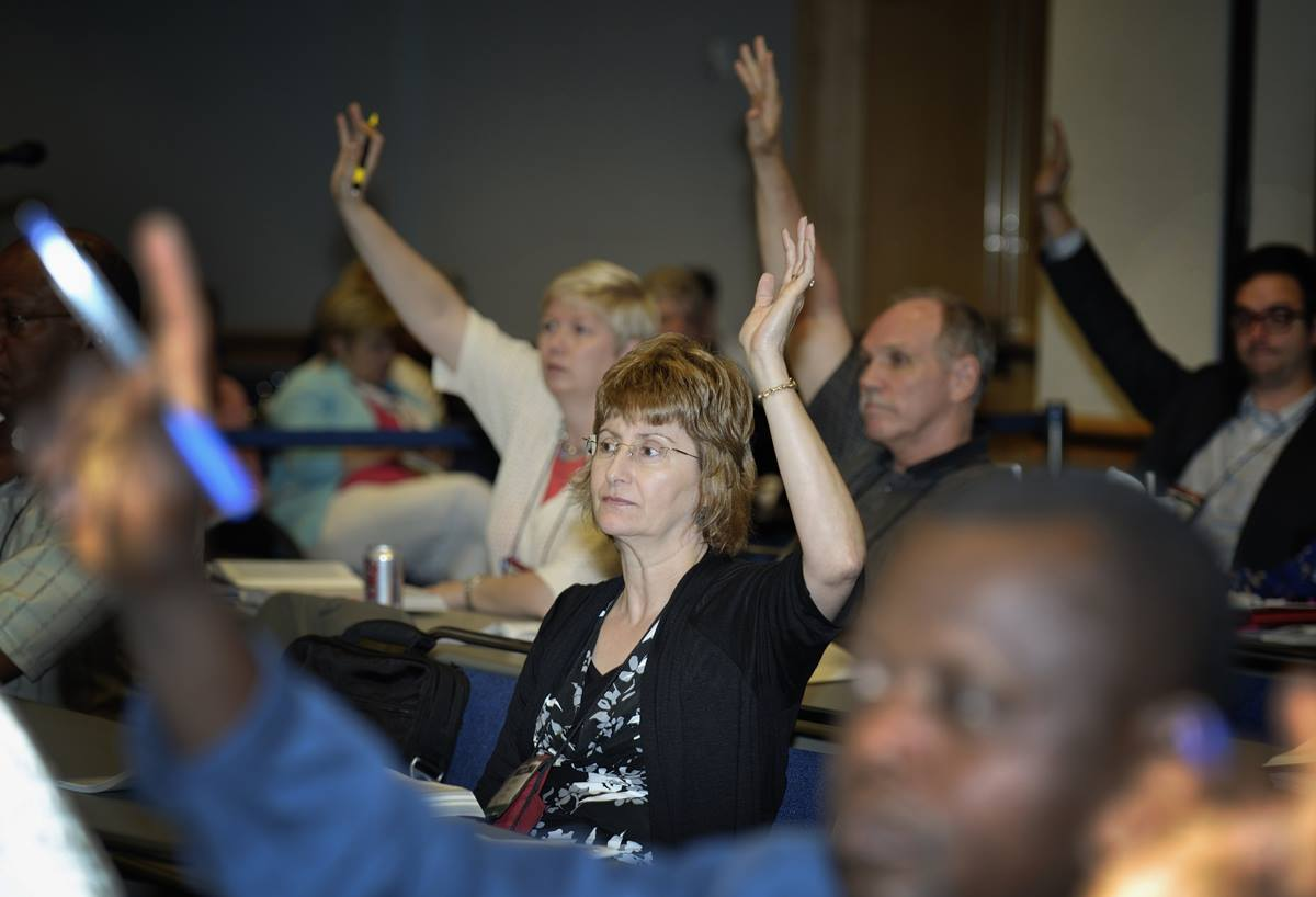 Committee members vote on proposed legislation during the 2012 United Methodist General Conference in Tampa, Florida. In 2016, delegates will be able to use machines to vote in legislative committees. Photo by Paul Jeffrey, UMNS