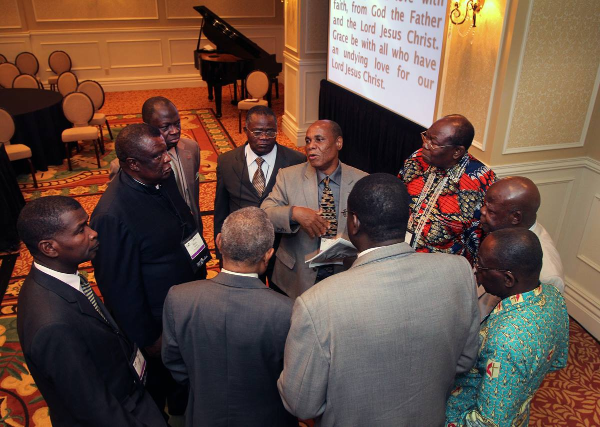 "Bishop Eben Nhiwatwa of Zimbabwe (center) holds a meeting of African bishops following the April 26, 2012 ""passing of the gavel ceremony."""