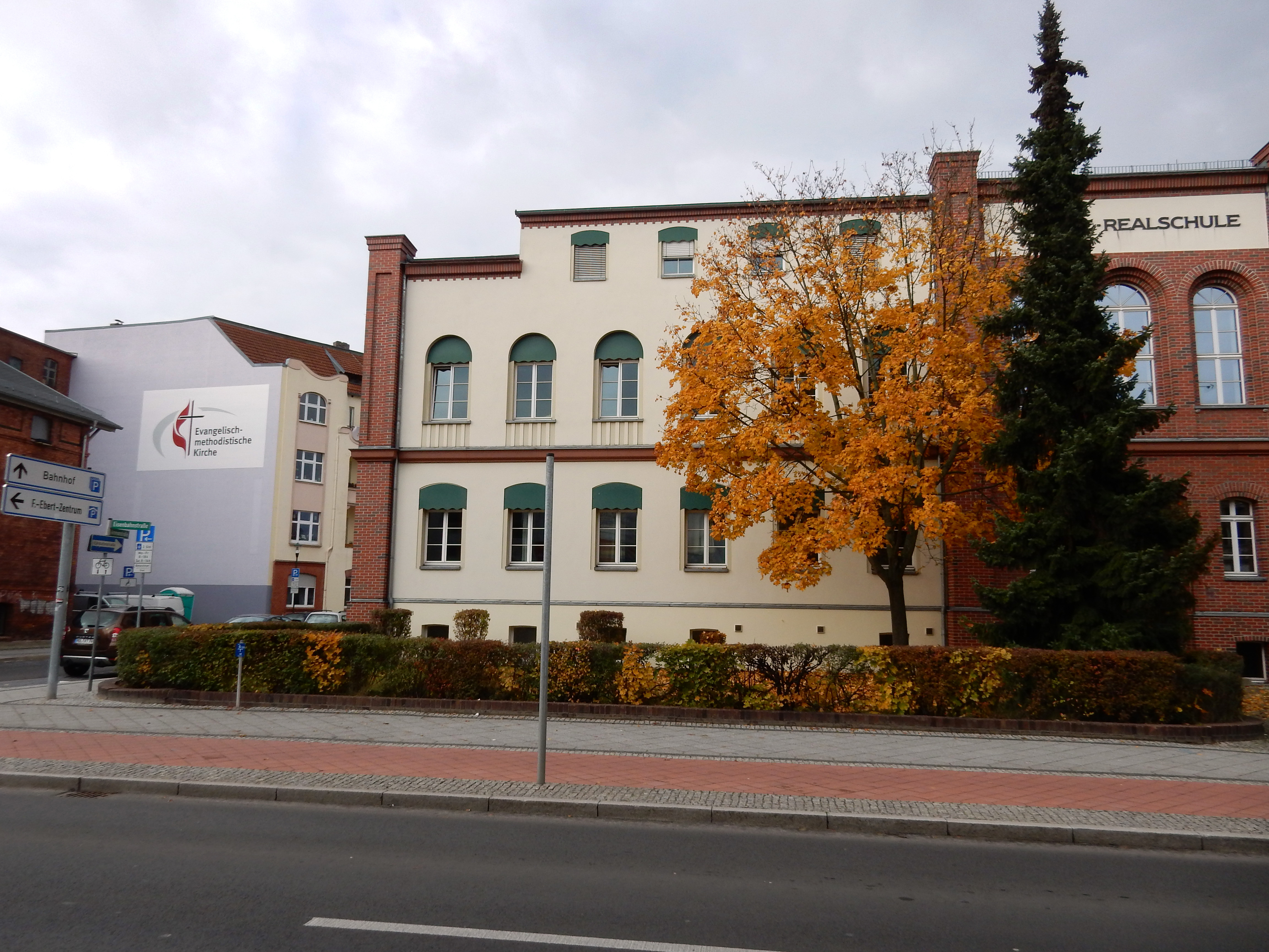 Immanuel United Methodist Church, at left, stands across the street in Eberswalde, Germany, from a former school that now serves as an emergency shelter for migrants seeking asylum. Photo by the Rev. Anne-Marie Detjen