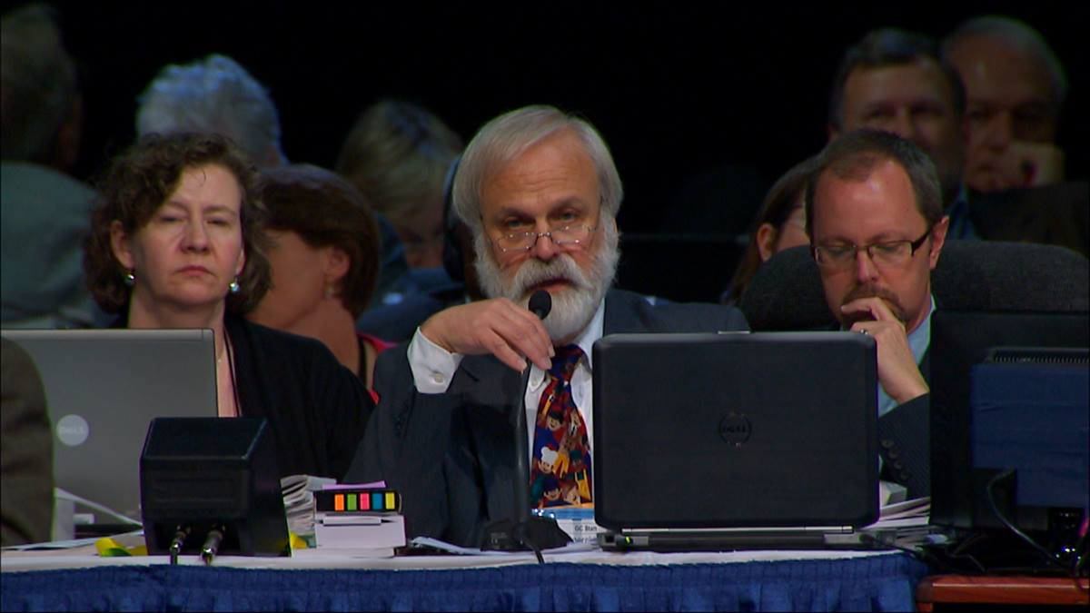 """The Rev. L. Fitzgerald """"Gere"""" Reist II announces to the 2012 General Conference that the Judicial Council has ruled Plan UMC, agency restructuring legislation, unconstitutional. Screengrab from United Methodist Communications video"""