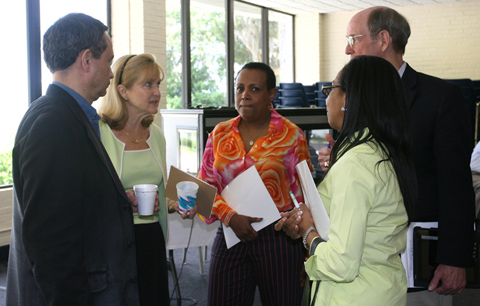 In 2010, the Council of Bishops and Connectional Table named a team of church leaders to reform agency structure. In this 2011 file photo, members of that team confer before addressing the Council of Bishops. Clockwise from left, team members pictured are Neil M. Alexander of the United Methodist Publishing House, laywoman Carol Tuthill of Ohio, laywoman Vicki Palmer, Ohio Area Bishop John L. Hopkins and laywoman Carolyn H. Byrd of Atlanta. File photo by Heather Hahn, UMNS