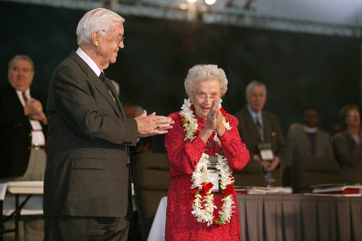 """Eunice Jones Mathews, """"wife, mother, author and noble soul,"""" died Feb. 27, 2016, at 101. In this 2004 file photo, she acknowledges applause as she was honored during a session of the United Methodist Church's 2004 General Conference in Pittsburgh. Standing at her side was her late husband, Bishop James, K. Mathews."""