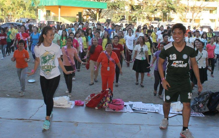 Faculty and students of Wesleyan University-Philippines in Cabanatuan City join the dance revolution to fight violence against women in observance of International Women's Day.