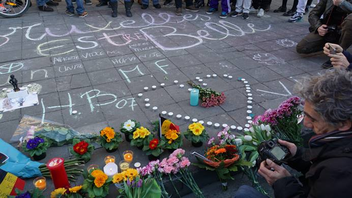 People gather at a memorial in Brussels for those killed and injured in Tuesday's terrorist attacks. Photo by Miguel Discart, Wikimedia Commons