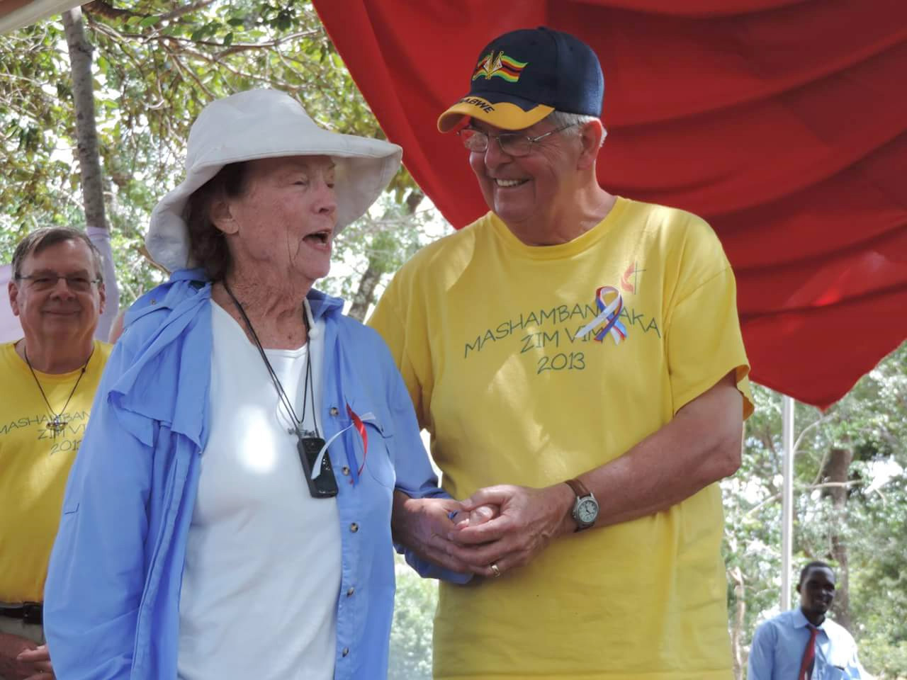 Claire Burrill, 90, and Charlie Moore help celebrate the dedication of new classrooms. Photo by Eveline Chikwanah
