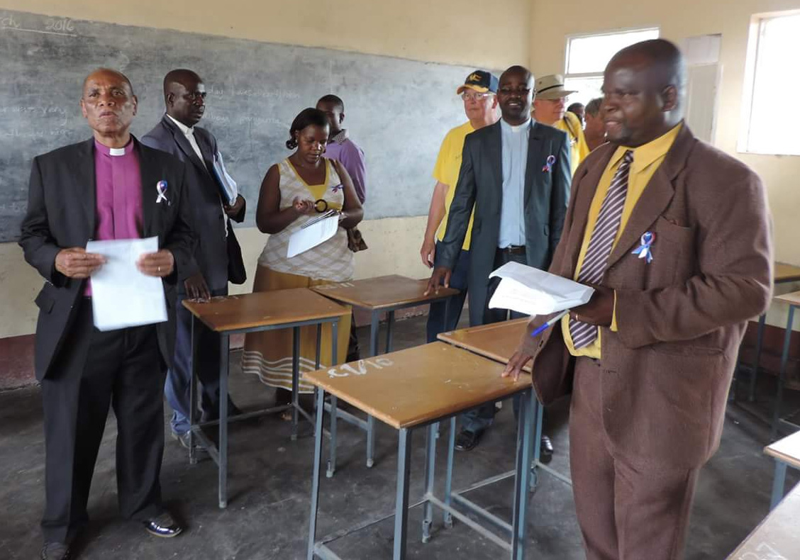 United Methodist Bishop Eben Nhiwatiwa (left) joins a tour of one of the new classrooms. Photo by Eveline Chikwanah