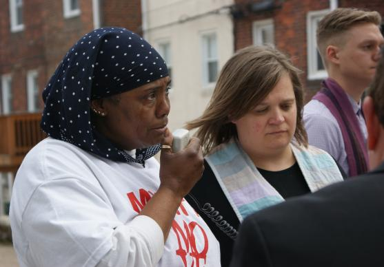 Movita Johnson-Harrell, who lost her son and nephew to gun murder, speaks during the Good Friday Memorial to the Lost walk in Philadelphia, sponsored by Heeding God's Call to End Gun Violence, an ecumenical faith-group which includes United Methodists. Photo by the Rev. Linda Noonan.