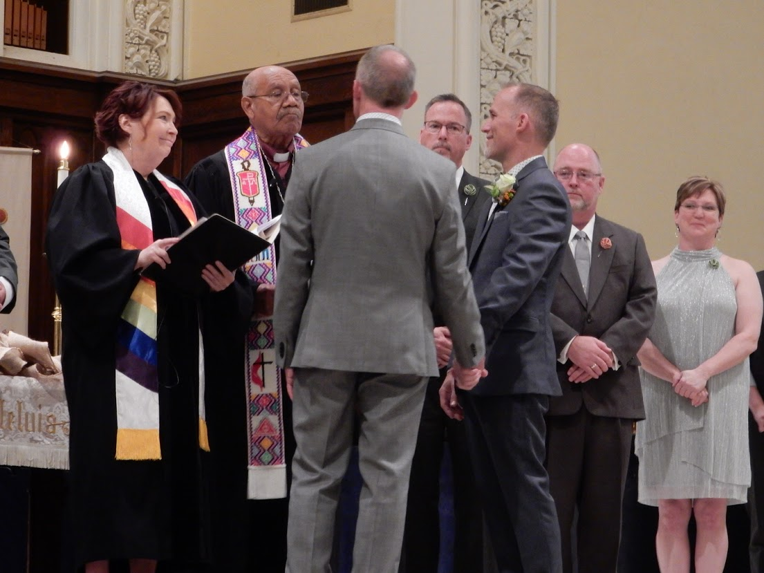 The Rev. Val Rosenquist, at left, and retired Bishop Melvin Talbert co-officiate at the wedding of Jim Wilborne and John Romano, both 52, at First United Methodist Church in Charlotte, N.C. Photo courtesy of Reconciling Ministries Network