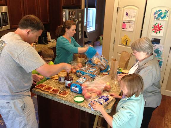 Leaders of SpiritSpace and their families prepare sandwiches to hand out to homeless individuals. SpiritSpace is among the new church starts in Portland, Ore.,  bringing people into Christian community.  Photo courtesy of the Rev. Beth Ann Estock