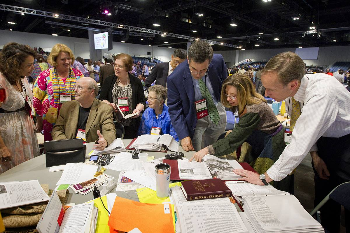 "Members of the Virginia delegation discuss possible next steps after the United Methodist Judicial Council ruled the proposed ""Plan UMC"" for church restructuring to be unconstitutional during the 2012 General Conference in Tampa, Fla. The council will consider a request for a declaratory decision on ""Plan UMC Revised"" when it meets in Portland, Ore., in advance of the 2016 General Conference. File photo by Mike DuBose, UMNS"