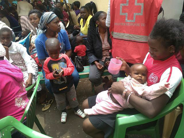Women and children who were in the collapsed building gather in a Red Cross tent. Photo by Anthony Maiga, UMNS
