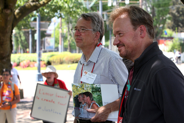 """The Rev. Mike Tupper (left) and the Rev. Frank Schaefer hold a press conference to speak about their call for sleeping outside on May 13 as part of National Tent Night """"to symbolize how the present policies of The United Methodist Church are pushing LGBTQ people outside."""" Tupper and Schaefer plan to sleep in a tent outside the Oregon Convention Center along with other supporters. Photo by Kathleen Barry, UMNS."""