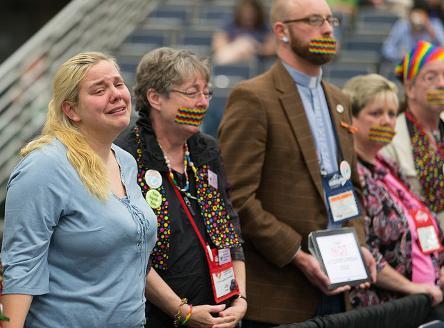 Supporters of full rights for LGBTQ persons in the life of The United Methodist Church, many with their mouths taped shut, stand outside the bar of the 2016 United Methodist General Conference in Portland, Ore., to symbolize the way LBGTQ people feel they are silenced by the church. Photo by Mike DuBose, UMNS