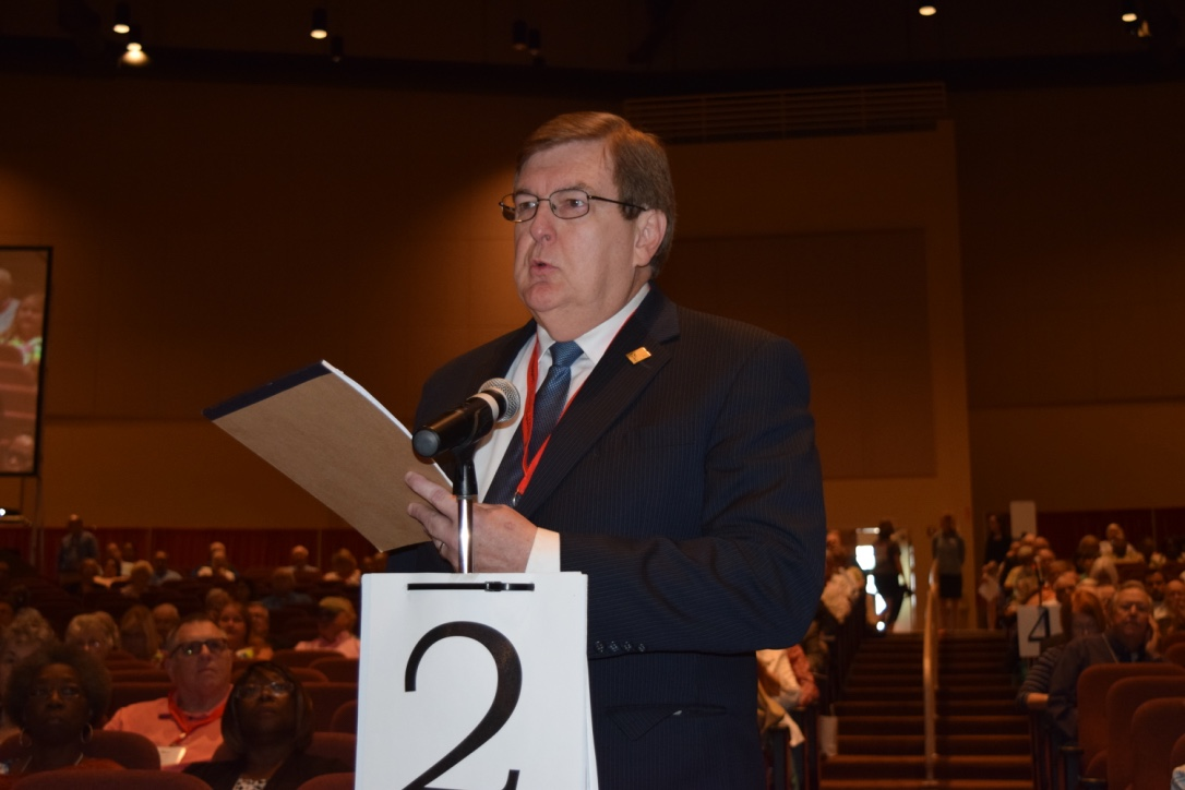 The Rev. Robert Beckum, senior pastor of St. Luke United Methodist Church in Columbus, Ga., makes a motion during the South Georgia Annual Conference's plenary session asking their resident bishop not receive, for appointment or transfer, clergy who have publicly stated their intent to disregard the current language of the Book of Discipline regarding human sexuality.