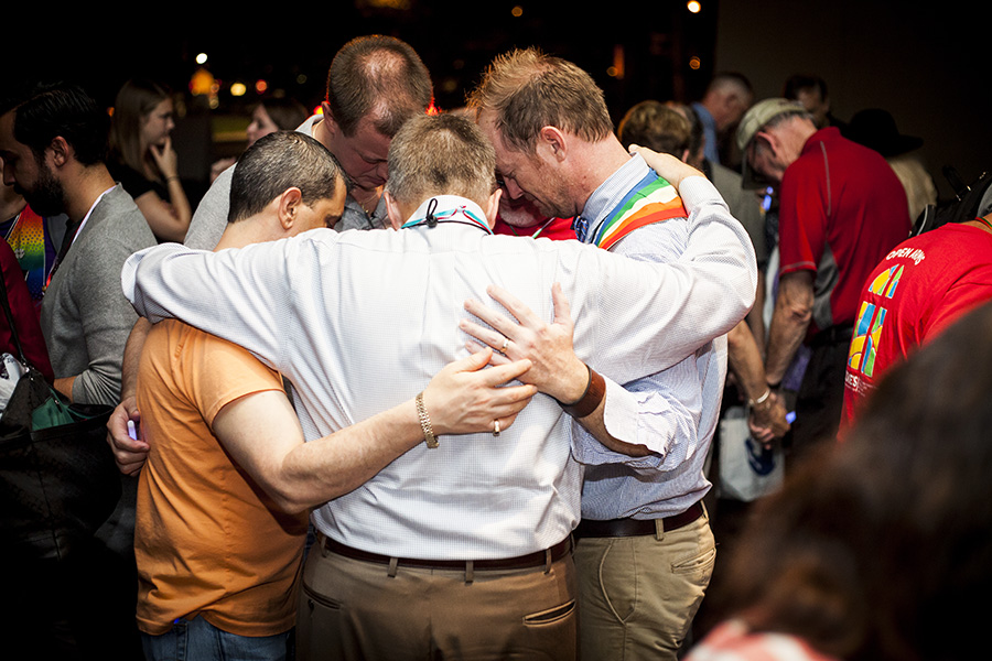Members of the Florida Conference of The United Methodist Church comfort one another during a prayer vigil in response to the mass shooting at Pulse, a gay nightclub in Orlando. The vigil was held in Orlando on the first day of the conference's yearly meeting. Photo by Lance Rothwell, Florida Conference