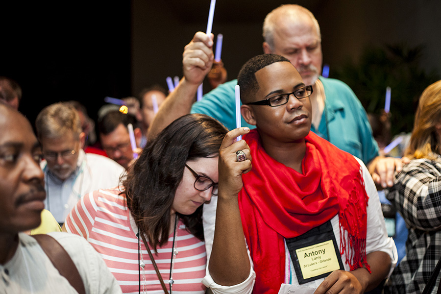 Members of the Florida Conference of The United Methodist Church hold glow sticks during a prayer vigil in response to the mass shooting at Pulse, a gay nightclub in Orlando. The vigil was held in Orlando on the first day of the conference's yearly meeting. Photo by Lance Rothwell, Florida Conference