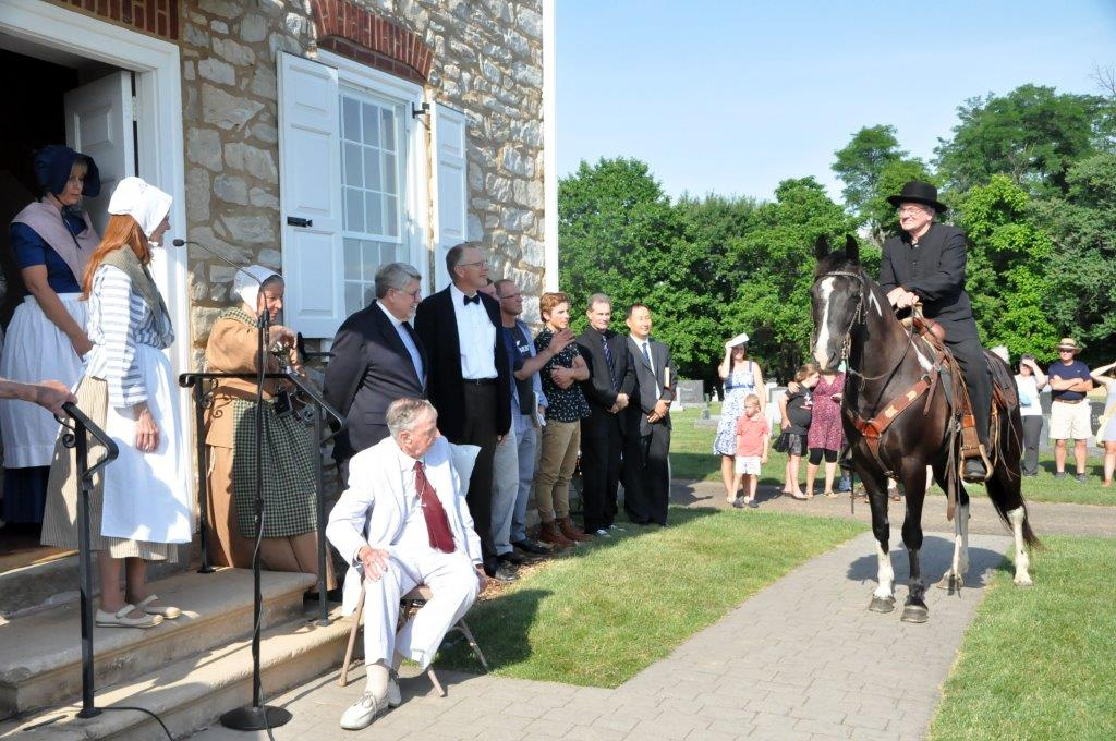 A colonial-era circuit-riding evangelist was part a special service on June 26 at Boehm's Chapel, a United Methodist heritage landmark near Lancaster, Pennsylvania. A trio of Mennonite bishops brought a proclamation reversing the 1775 ex-communication of Martin Boehm, a Mennonite who became a founder of the present-day United Methodist Church. Photo by John Coleman, Eastern Pennsylvania Conference