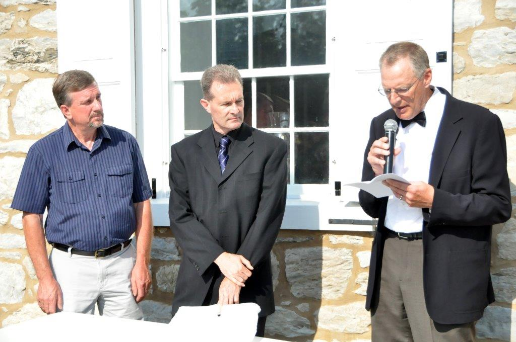From left, Bishops Lloyd Hoover and Robert Brody listen outside Boehm's Chapel as Bishop Stephen Weaver reads a proclamation from the Lancaster Mennonite Conference Board of Bishops re-instating Martin Boehm. Photo by John Coleman, Eastern Pennsylvania Conference