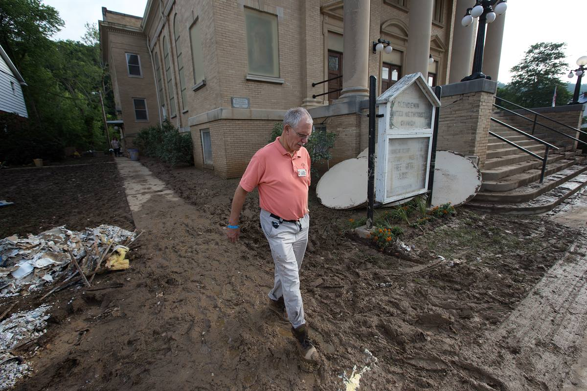 The Rev. J.F. Lacaria surveys flood damage at Clendenin (W. Va.) United Methodist Church. Photo by Mike DuBose, United Methodist Communications.