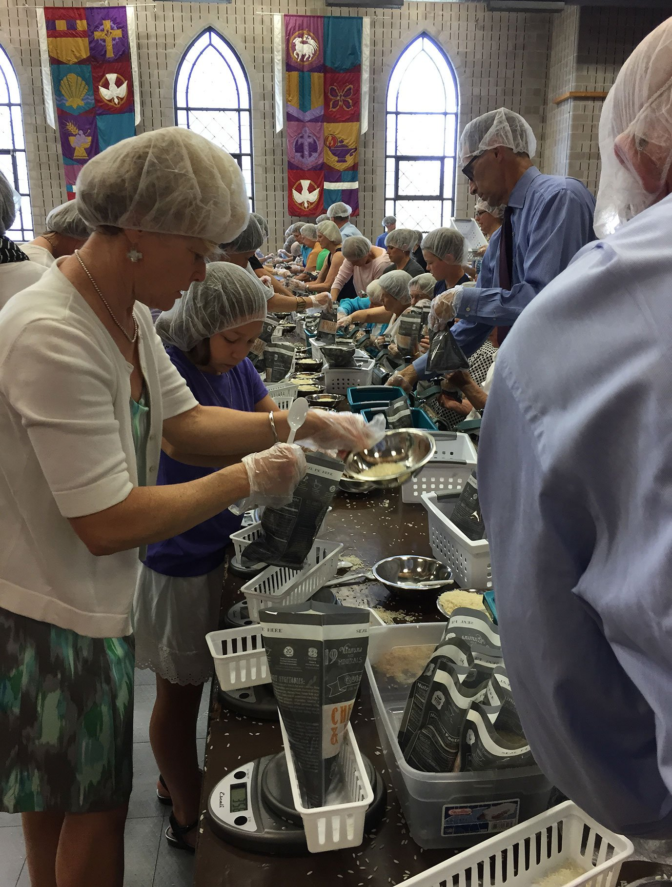 Members of Pulaski Heights United Methodist Church in Little Rock, Ark., pack meals for hungry families in the state. The church is among the congregations growing in worship attendance. Photo courtesy of Andrea Wymes