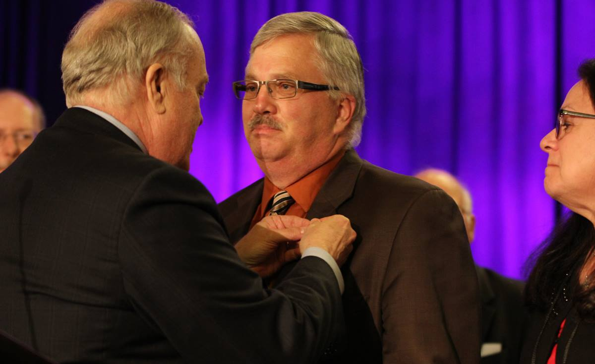 Dallas Area Bishop Michael McKee places an episcopal pin on the Rev. Bob Farr, newly elected United Methodist bishop of the South Central Jurisdiction. Farr was elected July 15, 2016, on the 35th ballot. Photo by Todd Siefert